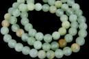 Rainbow jade, round, green, 6.5mm